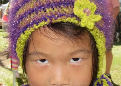 GIRL IN GREEN PURPLE HAT